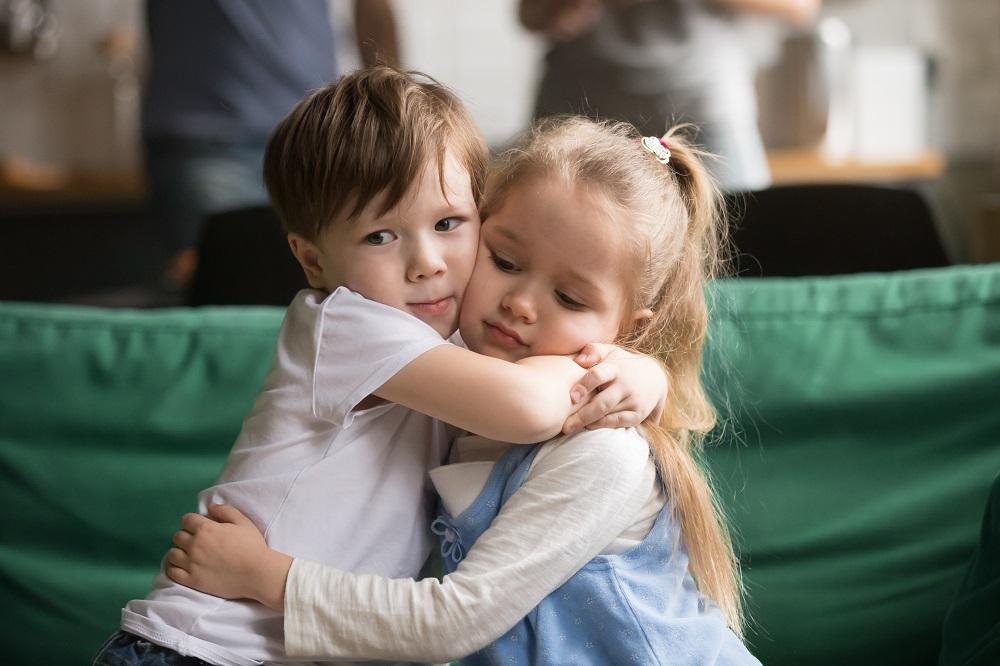 Preschool Boy and Girl Hugging