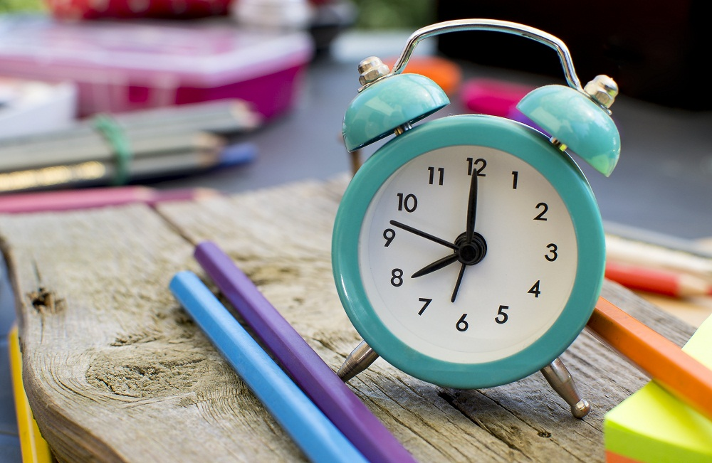 Little Teal Clock with Pencils Lying Around It at a preschool in Franklin, TN.