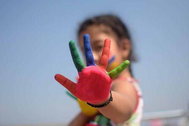 Child's Painted Fingers at preschool in Franklin TN